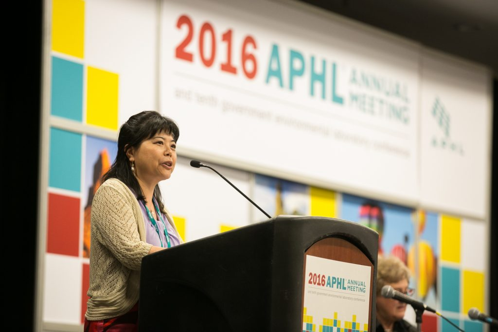 Lixia Liu, director of the New Mexico Department of Health Scientific Laboratory Division, welcomes attendees to Albuquerque