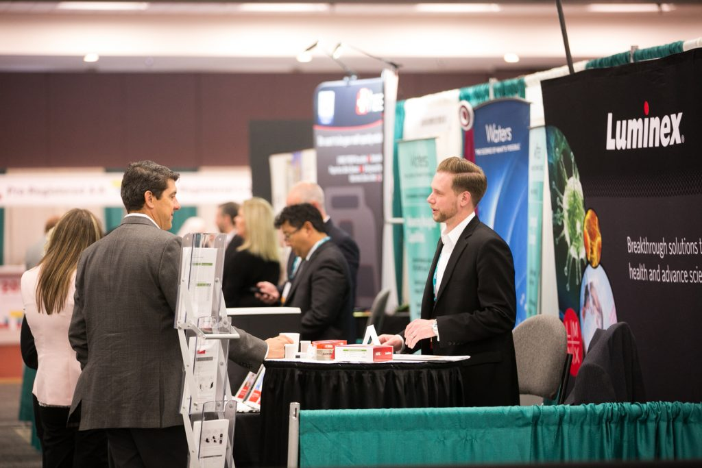 Meeting attendees visit exhibitors