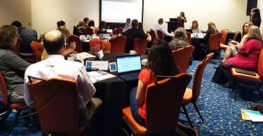 Attendees of the testing algorithms pre-HIV Diagnostic Conference workshop listen to a presentation.