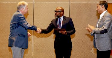 APHL's Jelili Ojodu receives the the Gerard Loeber Award for Contributions to Newborn Screening Expansion in Developing Countries