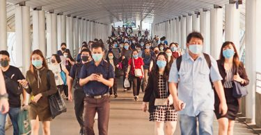 people in a group wearing masks