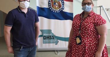 Matt Sinn and Jessica Bauer pose with the Missouri state flag