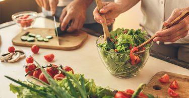 Preparing a salad in the kitchen