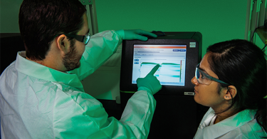 This image depicted two Enteric Diseases Laboratory Branch (EDLB) public health scientists, evaluating a whole genome sequencing run for quality control purposes. (CDC)