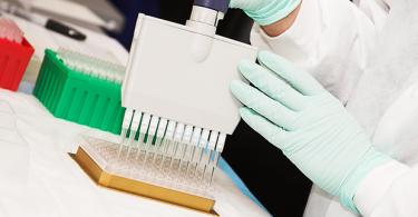Lab scientist performing test