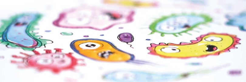 Cartoon drawing of microbes with silly faces.